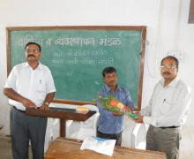 Dr.Shri. Bhagwat Sir Welcoming Shri. Bandopant Patil (Sales Tax Officer)